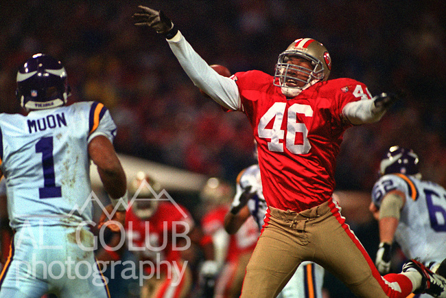 San Francisco 49ers vs. Minnesota Vikings at Candlestick Park Monday, December 18, 1995.  49ers beat Vikings  37-30.  San Francisco 49ers defensive back Tim McDonald (46) rushes Minnesota Vikings quarterback Warren Moon (1).