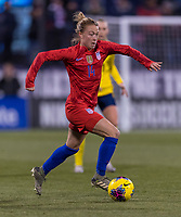 COLUMBUS, OH - NOVEMBER 07: Emily Sonnett #14 of the United States dribbles during a game between Sweden and USWNT at Mapfre Stadium on November 07, 2019 in Columbus, Ohio.