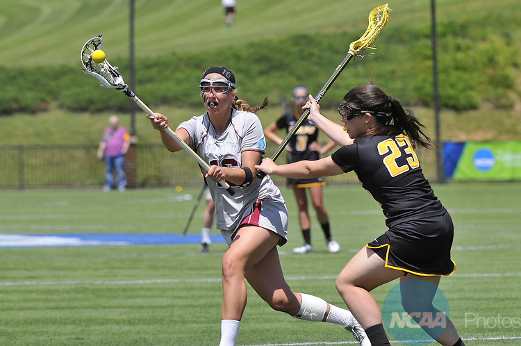 18 MAY 2014: Loch Haven's Jenna Dingler (16) is defended by Adelphi University Jen Graham (23) at the Division II Women's Lacrosse Championship held at Kerr Stadium in Salem, VA.  Adelphi defeated Lock Haven 7-5 to win the national title.  Andres Alonso/NCAA Photos