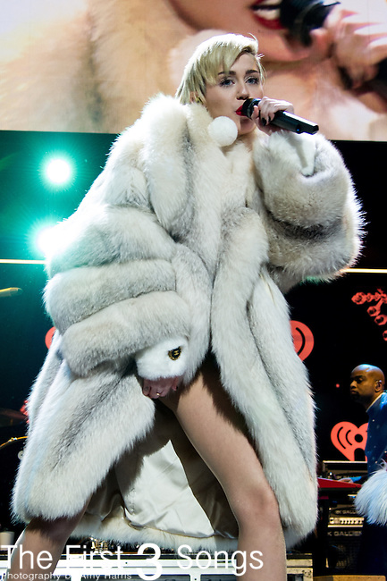 Miley Cyrus performs at the Hot 99.5's Jingle Ball 2013 presented by Overstock.com, at the Verizon Center on December 16, 2013 in Washington, D.C.