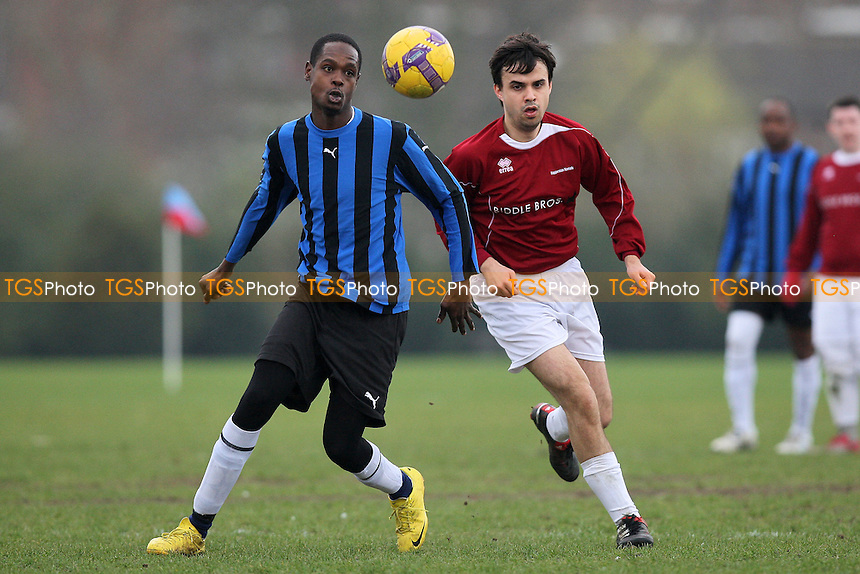 Maynell (blue/black stripes) vs Haggerston Nomads (maroon) - Hackney & Leyton Sunday League Football at South Marsh, Hackney Marshes, London - 13/03/11 - MANDATORY CREDIT: Gavin Ellis/TGSPHOTO - Self billing applies where appropriate - Tel: 0845 094 6026
