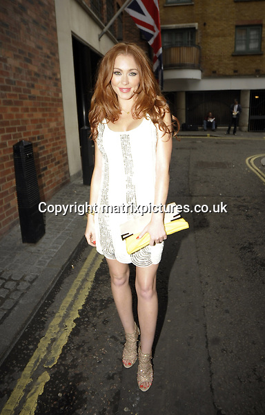 EXCLUSIVE ALL ROUND PICTURE: MATRIXPICTURES.CO.UK<br /> PLEASE CREDIT ALL USES<br /> <br /> WORLD RIGHTS<br /> <br /> English singer-songwriter Natasha Hamilton is spotted for the first time since the announcement of her split from husband of six years, Riad Erraji, as she leaves a Central London hotel.<br /> <br /> The former Atomic Kitten star, wearing a white cocktail dress, appeared to be in good spirits as she headed for a night out in Trafalgar Square.<br /> <br /> JULY 31st 2013<br /> <br /> REF: PSE 135265