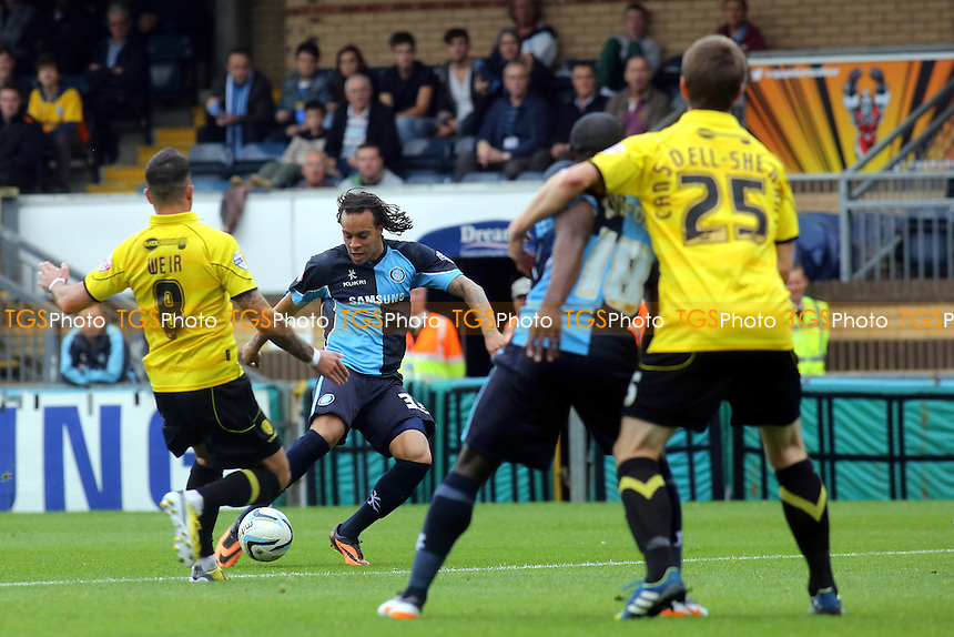 Wycombe's Charles Dunne hits a right foot shot towards the Burton goal - Wycombe Wanderers vs Burton Albion - Sky Bet League Two Football at Loakes Park, High Wycombe, Buckinghamshire - 05/10/13 - MANDATORY CREDIT: Paul Dennis/TGSPHOTO - Self billing applies where appropriate - 0845 094 6026 - contact@tgsphoto.co.uk - NO UNPAID USE