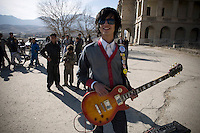 Sulyman Qardash, singer/guitarist in rock band Kabul Dreams plays his instrument in front of children in Kabul. Kabul Dreams is also made up of bass player Siddique Ahmad and drummer Mujtaba Habibi, and they claim to be the country's first and only rock and roll group.