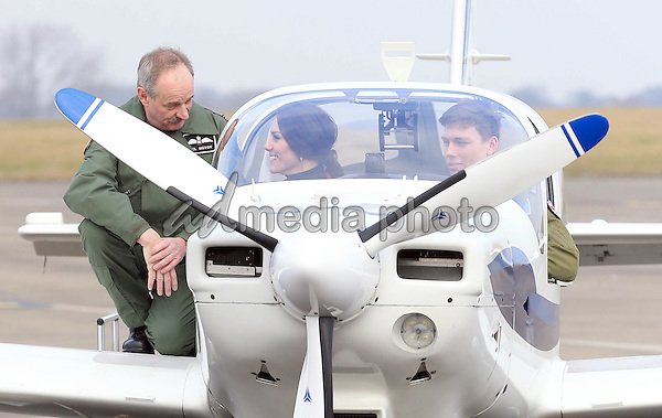 14 February 2017 - Princess Kate Duchess of Cambridge with Neil Moxon is seen inspecting a training plane during a visit to the RAF Air Cadets at RAF Wittering in Stamford, Lincolnshire.  The Duchess of Cambridge is Royal Patron and Honorary Air Commandant of the Air Cadet Organisation. Photo Credit: ALPR/AdMedia