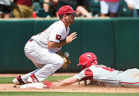 NWA Democrat-Gazette/CHARLIE KAIJO Arkansas outfielder Heston Kjerstad (18) slides to third during the second game of the NCAA super regional baseball, Sunday, June 10, 2018 at Baum Stadium in Fayetteville. Arkansas fell to South Carolina 5-8.