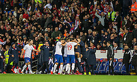 Aleksandar Mitrovic of Serbia is mobbed after scoring his side's equalising goal during the FIFA World Cup Qualifying match between Wales and Serbia at the Cardiff City Stadium, Cardiff, Wales on 12 November 2016. Photo by Mark  Hawkins.
