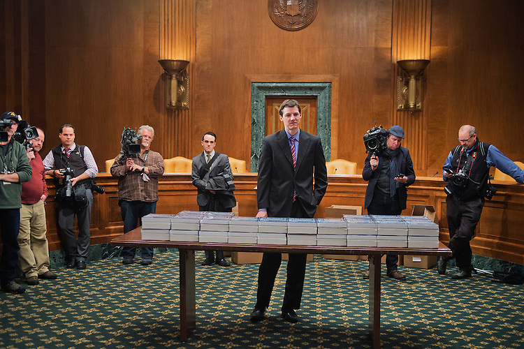 UNITED STATES - FEBRUARY 02: Media and staff including Eric Chalmers of the Senate Budget Committee wait for copies of President Obama's budget for fiscal year 2016, in Dirksen Building, February 2, 2015. (Photo By Tom Williams/CQ Roll Call)
