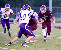 Photo by Randy Moll<br /> Jon Faulkenberry, Gentry senior and quarterback of the Pioneers, runs the ball on Friday, Sept. 1, in a home game against Lavaca.