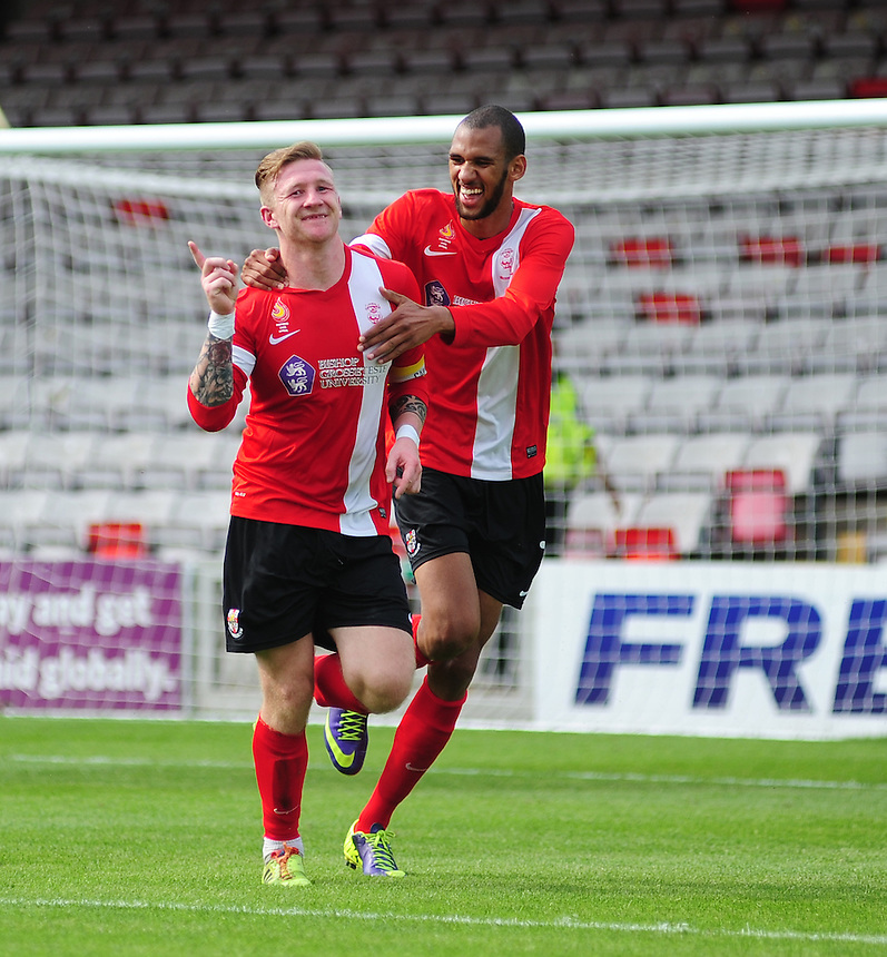 Lincoln City's Alan Power, left, celebrates scoring his sides second goal with team-mate Tony Diagne<br /> <br /> Photographer Chris Vaughan/CameraSport<br /> <br /> Football - Friendly - Lincoln City v Doncaster Rovers - Saturday 12th July 2014 - Sincil Bank Stadium - Lincoln<br /> <br /> &copy; CameraSport - 43 Linden Ave. Countesthorpe. Leicester. England. LE8 5PG - Tel: +44 (0) 116 277 4147 - admin@camerasport.com - www.camerasport.com