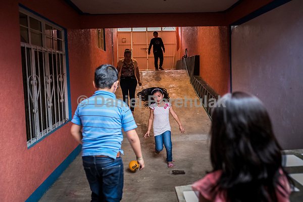 Vicky Delgadillo's grandchildren play with each other at a birthday party and family gathering at the house of Vicky's daughter, Cinthia Hernández Delgadilo's at her home in Xalapa, Mexico on November 4, 2017. <br /> Photo Daniel Berehulak for The New York Times