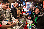 Vice President Joseph R. Biden, second from left, participates in the National Day of Service at the Unite America in Service event at the DC Armory on Saturday, January 19, 2013 in Washington, DC.