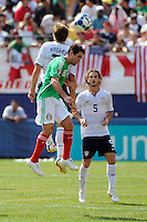 Jose Antonio Castro (15) of Mexico (MEX) and Robbie Rogers (7) of the United States (USA) go up for a header. Mexico (MEX) defeated the United States (USA) 5-0 during the finals of the CONCACAF Gold Cup at Giants Stadium in East Rutherford, NJ, on July 26, 2009.