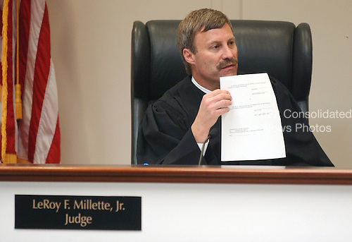 Prince William County (Virginia) Circuit Court judge LeRoy F. Millette, Jr., shows the jury a verdict form as they prepare to hear their instructions and closing arguements in the trial of sniper suspect John Allen Muhammad at the Virginia Beach Circuit Court in Virginia Beach, Virginia on November 13, 2003. <br /> Credit: Steve Earley - Pool via CNP