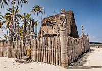 Rebuilt temple w/ tikis in Pu'uhonua o Honaunau place of refuge national historical park, Big Island, Hawaii