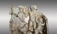 Close up of a Roman Sebasteion relief  sculpture of Agon Aphrodisias Museum, Aphrodisias, Turkey. <br /> <br /> The scene is an allegory of the athletic contest (or agon). The pillar was a beareded head of Hermes the god of the Gymnasium. Nearby is a palm of victory and a prize table with victory ribbon on it. Two winged baby Eros figures are struggling over a palm branch ( mostly broken): they act out the idea of contest, which is personified in the youthful figure behind. He hold another palm of victory: he is Agon himself.