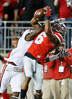 Ohio State Buckeyes wide receiver Evan Spencer (6) is unable to haul in a pass against Virginia Tech Hokies cornerback Brandon Facyson (31) in the third quarter at Ohio Stadium September 6, 2014. (Dispatch photo by Eric Albrecht)