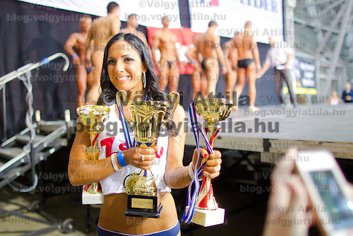 Competitor Zsofia Horvath winner of the over 165 cm category celebrates her victory during the Miss Zsaru (Miss Cop) contest in Budapest, Hungary on May 13, 2012. ATTILA VOLGYI
