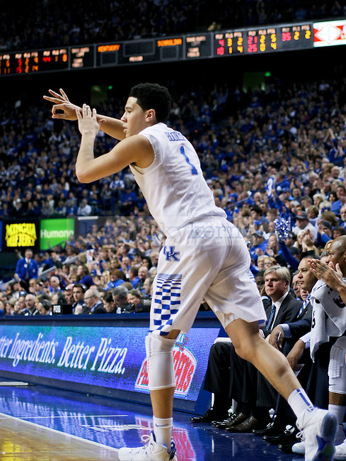 Kentucky guard Devin Booker throws up a hand sign after sinking a three point shot during the second half of the University of Kentucky Men's Basketball game versus University of South Carolina basketball game at Rupp Arena in Lexington , Fl., on Saturday, February 14, 2015. . Photo by Jonathan Krueger | Staff