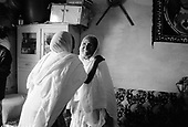 Asmara, Eritrea.November 2002.Birhan Aim Hospital  (Light to the Eye Hospital)..65 year old Asefash Ghebresilase arrives home surrounded by smiles from her friends and family as she sees them clearly for the first time in two years.