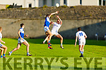 Kerins O'Rahillys Gavin O'Brien and Templenoe's John Rice battle in the air for possession in the Senior Club football championship