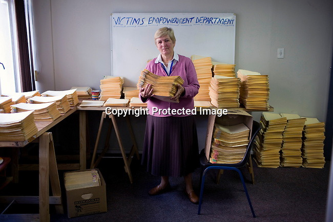 JOHANNESBURG, SOUTH AFRICA - APRIL 13: Majorie Jobson, a commissioner, holds case files of victims of apartheid in the Khulumani offices on April 13, 2010, in central Johannesburg, South Africa. She is involved in the Daimler complaint brought forward by victims of Apartheid. The plaintiffs argue that Daimler sold vehicles to the old South African government.(Photo by Per-AndersPettersson/Agentur Focus ForSpiegelMagazine)