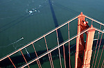 The sun casts a late afternoon shadow of the Golden Gate Bridge south tower on the bay.