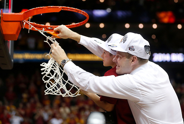 Iowa State head coach Fred Hoiberg, accompanied by his son, Sam,  cuts down the net after winning the Big 12 championship Saturday, March 15, 2014 in Kansas City, Mo.