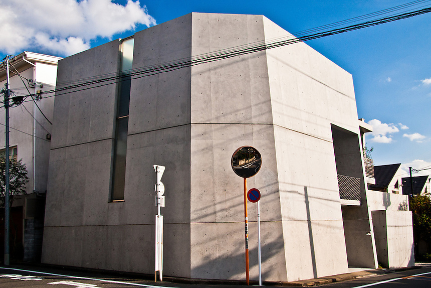 Unusual concrete bunker design for Tokyo home.Looks more like a missile silo.