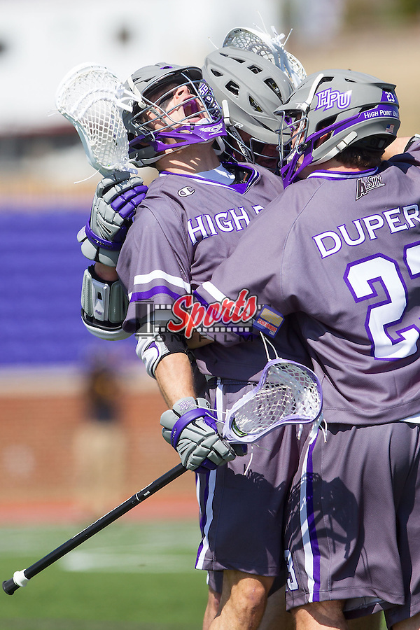 Bucky Smith (40) of the High Point Panthers celebrates with teammates after scoring a goal against the UMBC Retrievers at Vert Track, Soccer & Lacrosse Stadium on March 15, 2014 in High Point, North Carolina.  The Panthers defeated the Retrievers 17-15.   (Brian Westerholt/Sports On Film)