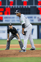Umpire Mark Bass keeps an eye on Pulaski Yankees starting pitcher Abel Duarte (45) during the game against the Danville Braves at American Legion Post 325 Field on August 2, 2016 in Danville, Virginia.  The game was cancelled due to rain.  (Brian Westerholt/Four Seam Images)