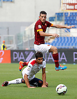 Calcio, Serie A: Roma vs Cagliari. Roma, stadio Olimpico, 21 settembre 2014.<br /> Cagliari defender Luca Rossettini, bottom, and Roma midfielder Alessandro Florenzi fight for the ball during the Italian Serie A football match between AS Roma and Cagliari at Rome's Olympic stadium, 21 September 2014.<br /> UPDATE IMAGES PRESS/Riccardo De Luca