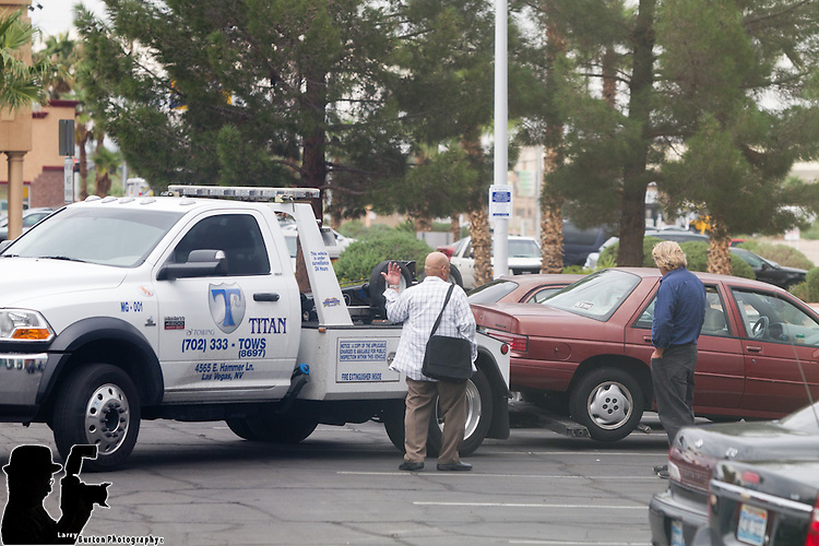 Titan Towing is staging an employee in the Blind Tiger Bar parking lot on Pecos in the same community parking lot as immigration from 8am until about 3pm, <br /> Although their side of the Lot is veaguly mark with signs at each end of the lot and stencil &quot;Bar Parking on the curb stop. The Titan employee waits until the driver is out of site and takes photos, calls wrecker, sweeps the lot three cars at a time then waits for the next round 18+ cars the first day 24+ cars on the 2nd day, @200.00 per car if you can get it out the same day. THe bar has 60 plus spots , and 2 + customers in the morning