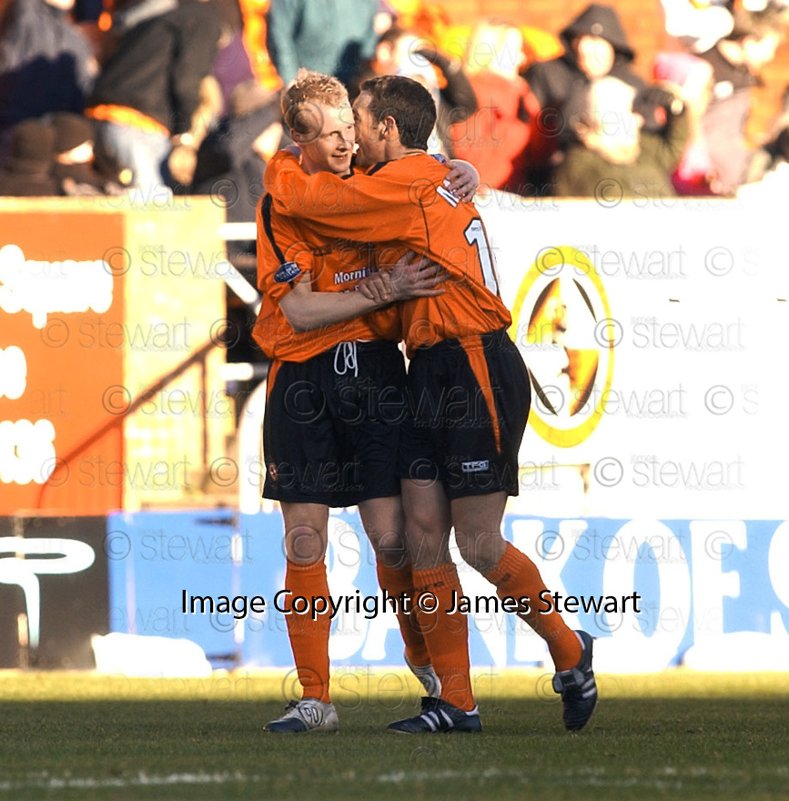 19/02/2005         Collect Pic : James Stewart.File Name : jspa05_dundee_utd_v_inverness.STUART DUFF IS CONGRATULATED AFTER HIS  CROSS IS HEADING INTO GOAL BY CALEY'S GRANT MUNRO ....Payments to :.James Stewart Photo Agency 19 Carronlea Drive, Falkirk. FK2 8DN      Vat Reg No. 607 6932 25.Office     : +44 (0)1324 570906     .Mobile   : +44 (0)7721 416997.Fax         : +44 (0)1324 570906.E-mail  :  jim@jspa.co.uk.If you require further information then contact Jim Stewart on any of the numbers above.........A