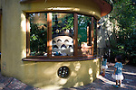 Young visitors look at the large Totoro toy that mans the ticket office at the Ghibli Museum in Mitaka City,  Tokyo, Japan on 16 Sept. 2012.  Photographer: Robert Gilhooly