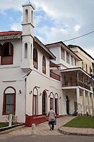 Stone Town, Zanzibar, Tanzania.  Ibadhi Mosque on Corner, Former American Consulate 1960s and 70s Behind.