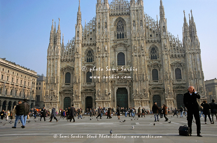 People bustling in the courtyard of the majestic Milan Cathedral, Milan, Italy.