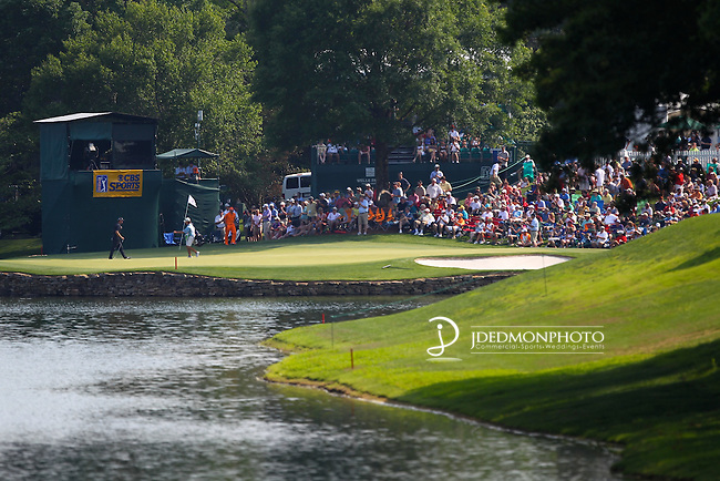 May 8,2011 - Rickie Fowler and Steve Marino putting out on 16 .  Lucas Glover wins the tournament in sudden death over Jonathan Byrd at Quail Hollow Country Club,Charlotte,NC.