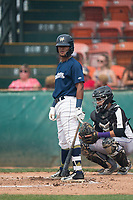 Helena Brewers center fielder Pablo Abreu (12) at bat in front of catcher Javier Guevara (6) during a Pioneer League game against the Grand Junction Rockies at Kindrick Legion Field on August 19, 2018 in Helena, Montana. The Grand Junction Rockies defeated the Helena Brewers by a score of 6-1. (Zachary Lucy/Four Seam Images)