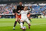 Luka Modric (r) of Real Madrid competes for the ball with Daniel Parejo Munoz of Valencia CF during their La Liga match between Real Madrid and Valencia CF at the Santiago Bernabeu Stadium on 29 April 2017 in Madrid, Spain. Photo by Diego Gonzalez Souto / Power Sport Images