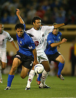 24 March 2004: Earthquakes' Brian Ching battles for the ball against LD Alajuelense's Luis Diego Amaez during the CONCACAF Champions Cup at Spartan Stadium in San Jose, California.   San Jose won the game, final score: 1-0.