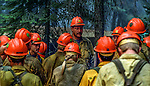 August 15, 1990 Yosemite National Park  --  A-Rock (Arch Rock) Fire  -- Mendocino Hotshots superintendent gives crew briefing before heading out on the trail. The Arch Rock Fire burned over 16,000 acres of Yosemite National Park and the Stanislaus National Forest.  At the same time across the Merced River, the Steamboat Fire burned over 5,000 acres of both Yosemite National Park and the Sierra National Forest.