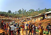 Gitega, Burundi. Overview of bustling market with people coming and going.