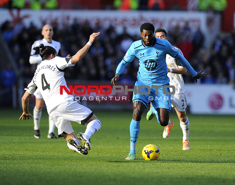 Swansea City's Chico tackles Tottenham Hotspur's Emmanuel Adebayor -   19/01/2014 - SPORT - FOOTBALL - Liberty Stadium - Swansea - Swansea City v Tottenham Hotspur - Barclays Premier League<br /> Foto nph / Meredith<br /> <br /> ***** OUT OF UK *****
