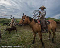 helping hand Cowboys working and playing. Cowboy Cowboy Photo Cowboy, Cowboy and Cowgirl photographs of western ranches working with horses and cattle by western cowboy photographer Jess Lee. Photographing ranches big and small in Wyoming,Montana,Idaho,Oregon,Colorado,Nevada,Arizona,Utah,New Mexico. Fine Art Limited Edition Photography Of American Cowboys and Cowgirls by Jess Lee