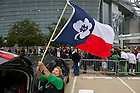 Oct 5, 2013; Barbara Burns of San Antonio, Texas, takes down her Notre Dame themed Texas state flag outside the stadium.<br /> <br /> Photo by Matt Cashore