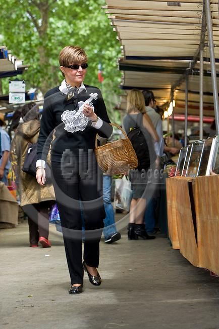 PARIS - FRANCE - 08 MAY 2011 -- Paris travel city photos. -- Helena Petäistö on the biggest organic food market of France, Boulevard Raspail. -- PHOTO: Juha ROININEN / EUP-IMAGES