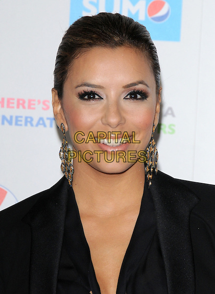 """EVA LONGORIA PARKER.""""Latinos Living the American Dream"""" Los Angeles Premiere held at Grauman's Chinese Theatre, Hollywood, California, USA..October 21st, 2010.headshot portrait black gold silver dangling earrings hair up make-up beauty smiling.CAP/RKE/DVS.©DVS/RockinExposures/Capital Pictures."""