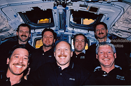 On Discovery's flight deck, the STS-82 astronauts pose for the traditional inflight crew portrait.  The Hubble Space Telescope (HST), latched down in the Shuttle's cargo bay, is partially visible in the background.  A total of five days of extravehicular activity (EVA) were used to service the orbiting observatory.  Front row, left to right, are astronauts Scott J. Horowitz, pilot; Kenneth D. Bowersox, commander; and Steven A. Hawley, mission specialist.  On the back row are the other mission specialists -- astronauts Steven L. Smith, Gregory J. Harbaugh, Mark C. Lee (payload commander) and Joseph R. Tanner.<br /> Credit: NASA via CNP