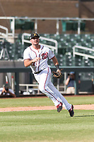 Salt River Rafters third baseman Jake Noll (17), of the Washington Nationals organization, after making a running throw to first base during an Arizona Fall League game against the Surprise Saguaros at Salt River Fields at Talking Stick on October 23, 2018 in Scottsdale, Arizona. Salt River defeated Surprise 7-5 . (Zachary Lucy/Four Seam Images)